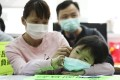 Four-year-old Huang Zijuan and her mother Wen Qifei (left) share the difficulties they have faced amid the coronavirus epidemic during a press conference organised by Society for Community Organisation in Sham Shui Po on February 23. Photo: Nora Tam