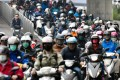 Motorcyclists wear face masks during the morning commute in Taipei. Photo: AFP