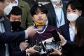 """Cho Ju-bin outside a police station in Seoul on Wednesday. The 24-year-old is accused of running the """"nth rooms"""" in South Korea. Photo: Reuters"""