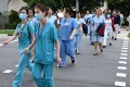 Medical staff walk to the National Centre for Infectious Diseases building at Tan Tock Seng Hospital in Singapore. Photo: AFP