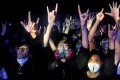 Fans wear masks to a concert at the venue, Hidden Agenda: This Town Needs, on February 27 amid a coronavirus outbreak. Photo: Reuters