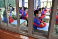 Students were back in class at the Xian Middle School in Shaanxi province on Monday after a nationwide closure because of the coronavirus outbreak. Photo: Xinhua