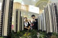 A sales assistant speaks to a customer at a property exhibition in Shanghai as home sales spring back to life after sales offices reopened across China. Photo: Reuters