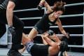 China's Meng Bo throws punches down on Laura Balin. Photos: One Championship