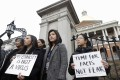 Demonstrators, including members of the Massachusetts Asian-American Commission, protest on March 12 at the statehouse against what racism and fearmongering aimed at Asian communities amid the coronavirus outbreak. Photo: AP
