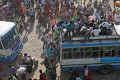 Migrant workers in Ghaziabad, on the outskirts of New Delhi, climb onto crowded buses as they try to return to their home villages during a 21-day nationwide lockdown to limit the spread of coronavirus in India. Photo: Reuters