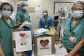 Medical workers at a Staten Island hospital in New York receive face masks donated by the Chinese community in the US and their counterparts in China. Photo: Xinhua