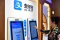 A woman buys medicine through Alipay's face-scanning service at a chemist in Zhengzhou, capital of central China's Henan Province. Photo: Xinhua