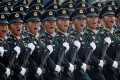 PLA soldiers march in formation during the military parade marking the 70th year anniversary of the PRC. China's 'civil-military' fusion aims to build up its military might and supercharged technological development in tandem. Photo: Reuters