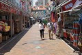 People wearing face masks walk past shops in Chinatown in Singapore. Photo: AFP