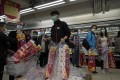 Customers queue to buy toilet paper in a Hong Kong supermarket in February. Photo: AP