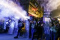Police fire tear gas against protesters in Sham Shui Po in August 2019. Photo: Reuters
