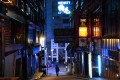 A man walks down a deserted street in the usually bustling nightlife district of Lan Kwai Fong in Central on March 27. The government has ordered a two-week shutdown of pubs and bars to contain the spread of Covid-19. Photo: Sam Tsang