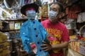 Paper crafting master Au Yeung Ping-chi has experimented with making paper replicas of Hong Kong's ubiquitous surgical masks. But as the real thing is considerably cheaper, he does not see much market for them. Photo: May Tse