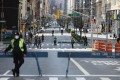 People are seen taking a walk and getting fresh air while social distancing on the closed of Park Avenue on March 27, 2020 in New York City. Photo: AFP