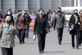 Pedestrians wear face masks in Pyongyang, as North Korea maintains that there are no coronavirus infections in the country yet. Photo: AP