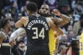 Milwaukee Bucks forward Giannis Antetokounmpo (34) gives Los Angeles Lakers forward LeBron James (23) a hug after an NBA game. Photo: USA Today