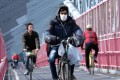 A New York City cyclist wearing a mask on March 18. Photo: Getty Images/AFP