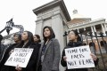 Asian-Americans from Boston's Asian-American Commission protest on the steps of the Statehouse on March 12, against racism, fearmongering and misinformation aimed at Asian communities amid the pandemic. Photo: AP