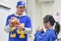 NFL star Taylor Rapp signs a football for a student at Castelar Street Elementary School last year. Photo: Handout