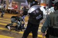 Anti-government protesters clash with riot police outside Prince Edward MTR station in December last year. Photo: Edmond So
