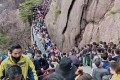 The crowds flocking to the Huangshan in Anhui province highlight the difficulties the country may face in future as it tries to get back to normal while keeping Covid-19 under control. Photo: Weibo