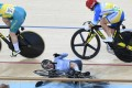Sarah Lee is seen crashing out in the backbend after a clash with Anna Meares (no 164) of Australia during the second round of the keirin at the 2016 Rio Olympics. Photo: EPA