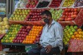 An Indian fruit seller waits for customers at his shop in Mumbai on April 3, 2020. Photo: EPA-EFE