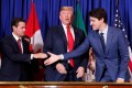 Mexican President Enrique Pena Nieto and Canadian Prime Minister Justin Trudeau shake hands while US President Donald Trump looks on at a 2018 signing ceremony for the United States-Mexico-Canadian Agreement. A Pew Research Centre survey shows sentiment toward the US is decidedly mixed. Photo: Reuters