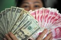 The Chinese yuan's exchange rate has slipped by 1.7 per cent against the US dollar so far this year. Photo: Xinhua