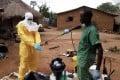 A health worker prepares to degown in Sierra Leone. Photo: Handout