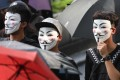 Protesters last year with Guy Fawkes masks. Photo: Xiaomei Chen