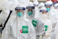 Nurses wearing protective suits line up to enter a treatment ward for Covid-19 patients in Daegu, South Korea. East Asia has received global acclaim for its success in fighting the coronavirus pandemic. Photo: DPA