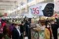 A 5G-powered camera scans temperatures at a market in Suzhou, Jiangsu province, amid the coronavirus outbreak, on February 20. Photo: Reuters