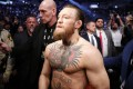 Conor McGregor celebrates his first-round TKO victory as he exits the arena against Donald Cerrone at UFC 246. Photo: AFP