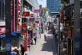 A handful of people walk on the usually busy Takeshita street in Tokyo's Harajuku district on Wednesday. Photo: AFP