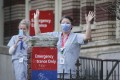 Health care workers acknowledge applause from people outside St Paul's Hospital in Vancouver on Monday. Photo: Xinhua