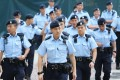 The Hong Kong Police Force not only missed recruitment targets by more than 40 per cent in the past year, they saw nearly 450 officers quit their jobs before retirement age. Photo: Dickson Lee