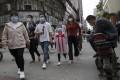 People walk along a retail street in Wuhan on Wednesday as lockdown measures were eased. Photo: AP