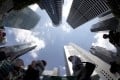 People walk past office buildings in the central business district in Singapore. Photo: Reuters