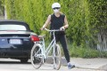 Jennifer Garner snapped walking with her bicycle wearing sunglasses, a helmet and a face mask in Los Angeles, California. The paparazzi are getting increasing desperate for pictures of celebrities in the US. Photo: GC Images