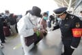 Officials at Wuhan Railway Station check passenger codes as the city's travel lockdown lifts. Photo: Simon Song