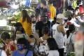 People wearing masks buy food at a market in Metro Manila, Philippines. Photo: AP