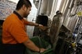 Beer brewer Boris Yeung collects spent grains at Little Creatures Brewing in Kennedy Town, Hong Kong. Since last summer the microbrewery has been sending the discarded grain to Hong Kong Community Composting. Photo: Jonathan Wong