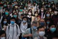 Hong Kong commuters in masks, going to work in Central. Photo: May Tse