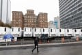 Refrigeration trucks are lined up near the office of New York's chief medical examiner to serve as an expanded morgue on April 3, as the city prepared for a growing number of coronavirus deaths. Photo: EPA-EFE