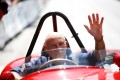 Former Formula One driver Stirling Moss waves to spectators as he sits in his 1955 Ferrari 750 Monza during the Ennstal Classic rally near the Austrian village of Groebming in this July 20, 2013. Photo: Reuters