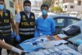 Chinese citizen Zhang Tianxing (right) was arrested in Lima, Peru on Sunday. Photo: Peruvian national police via AFP