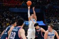 Jeremy Lin shoots for the Beijing Ducks in the Chinese Basketball Association. Photo: Xinhua