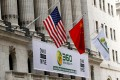 The US and Chinese flags outside the New York Stock Exchange in 2011. Take-private deals of US-listed Chinese firms like Qihoo 360 could increase as a result of recent accounting lapses at Luckin Coffee, some bankers say. Photo: Reuters